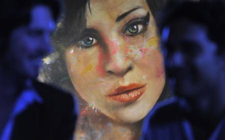 A painting 'Amy' by British artist Andersson is seen hanging at a pub in central London
